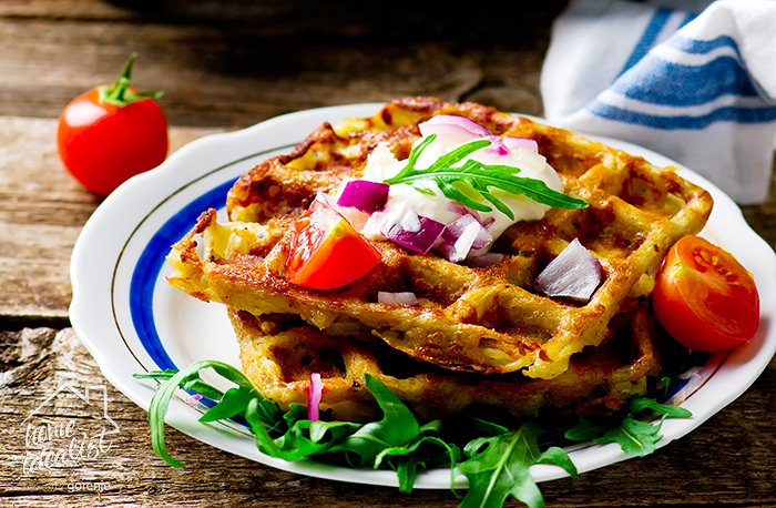 potato waffle with sour cream  and  green salad on a plate.style rustic .selective focus