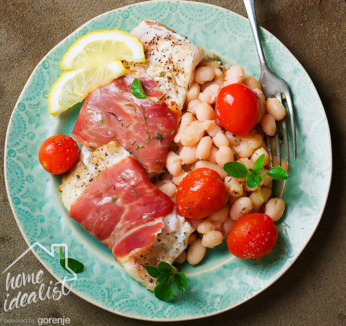 the baked cod with cherry tomato and beans.selective focus
