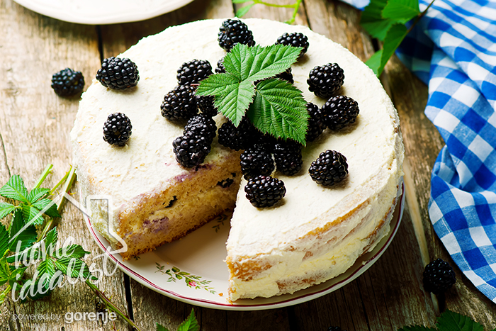 Honey cake with blackberry and whipped cream.